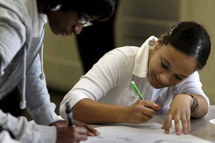 Mia Cruse, right, and Tanyell Ellis work on an assignment on the first day of school.