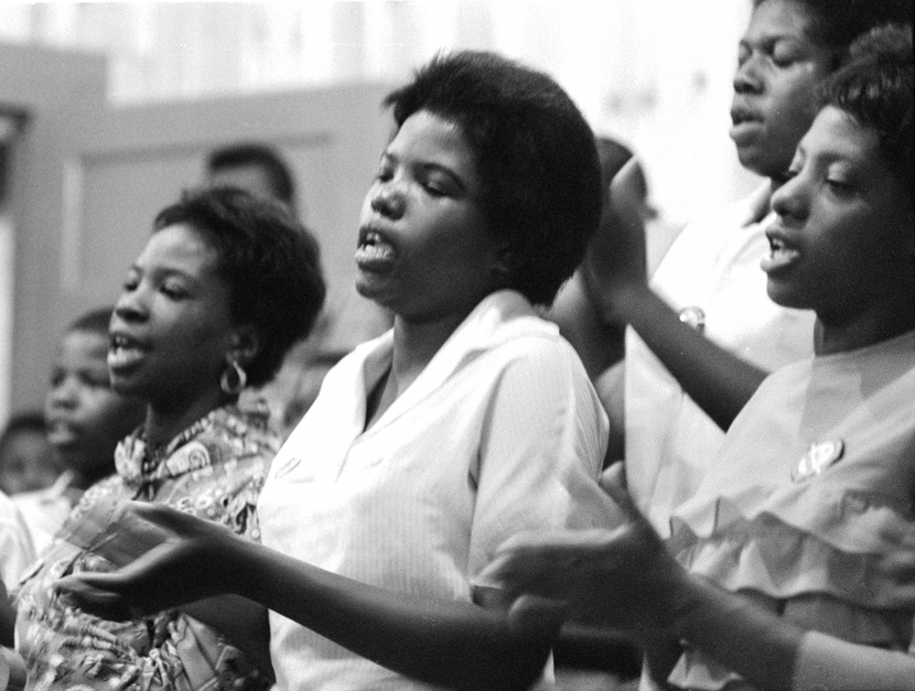Young women singing freedom songs