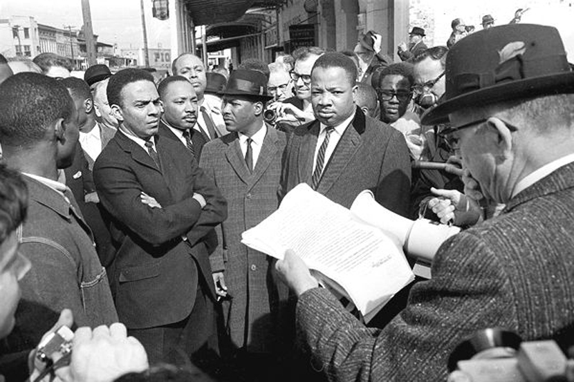 At the Edmund Pettus Bridge on March 9, 1965, a federal marshal reads an injunction to Andrew Young