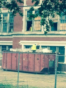 Unidentified workers cleaning the former site of John McDonogh High School as recently as mid-May.