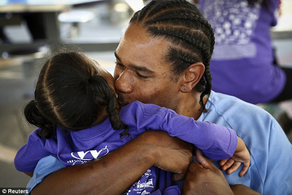 Folsom prisoner, Haywood holds his daughter tightly